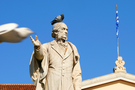 Statue of a man in front of the University of Athens, Greece Reklamní fotografie