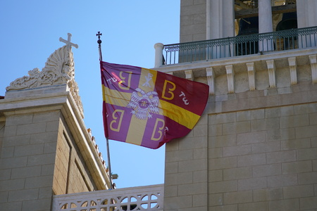Greek national orthodox church flag waving on the cathedral