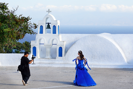 OIA - GREECE, SEPTEMBER 19 2018 SHOOTING VIDEO OF A BRIDE IN BLUE DRESS Editorial