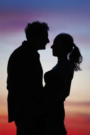 silhouette of a loving couple on a sunset background Archivio Fotografico