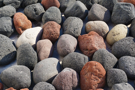Detail of stones of various colors in Oia, Santorini, Greece Stock Photo