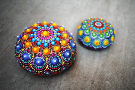 Beautiful mandala rocks on gray background Stock Photo