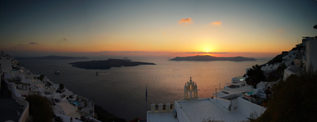 Panoramic view of the Caldera with cruise ship in Santorini, Greece