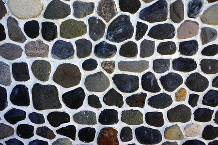 Detail of brown stones on cement in Oia, Santorini, Greece Stock Photo
