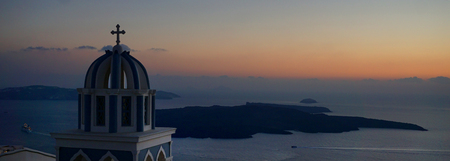 Beautiful sunset with domes of churches in Imerovigli, Santorini, Greece