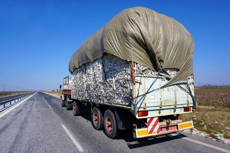 A truck delivers cotton on the street for Lamia, Central Greece