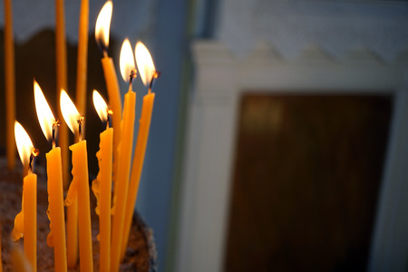 Burning candles in a small Orthodox church in Greece Stock Photo