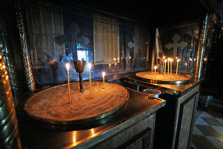 Lighted candles in the monastery of the Virgin Mary in Paleokastritsa, Greece