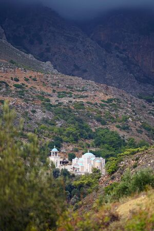 View of the countryside with Monastery of St. Nicholas in Zaros , Crete, Greece