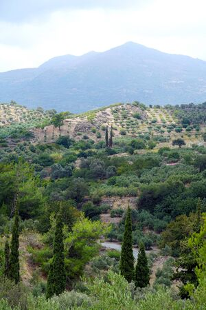 View of the countryside, of the hills with mountains in the background in Crete, Greece
