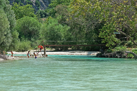 Parga, Greece, July 12 2018, Tourists stroll in the Acheron River with its pristine nature in Epirus, Greece Editöryel