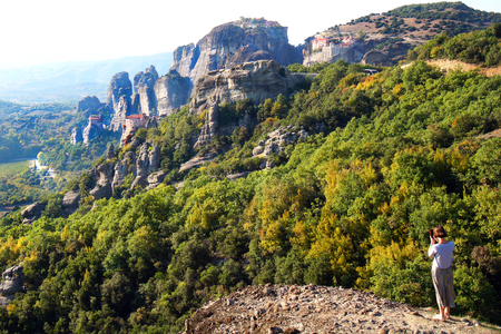 Meteora, Greece,October 11 2018, A tourist takes a picture of the panorama with a cell phone