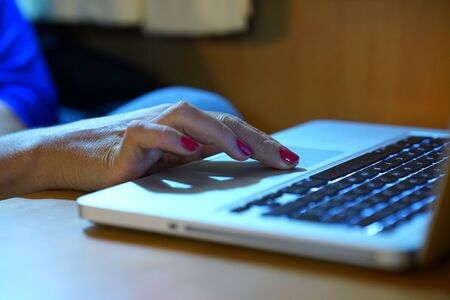 Woman's hands working on computer keyboard