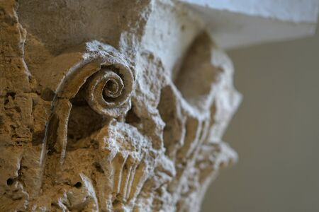 Detail of a column in the archaeological site of Epidaurus, Greece