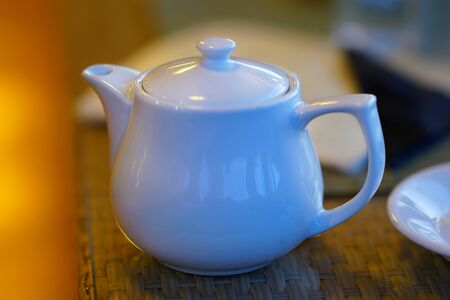 Teapot on a bar table against a blurred background , detail