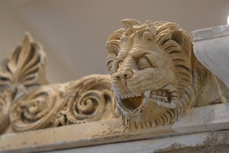 Detail of the statue of a lion lying in the archaeological site of Epidaurus, Greece