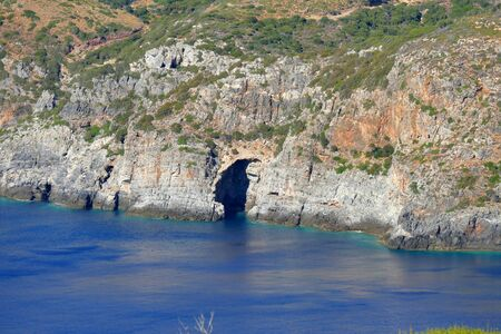 Beautiful scenery of the entrance of a cave in the western coast of Kythera in the Aegean Sea, Greece
