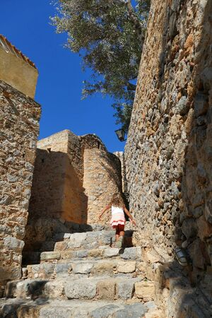 A little girl visit the city inside the mythical castle of Monemvasia