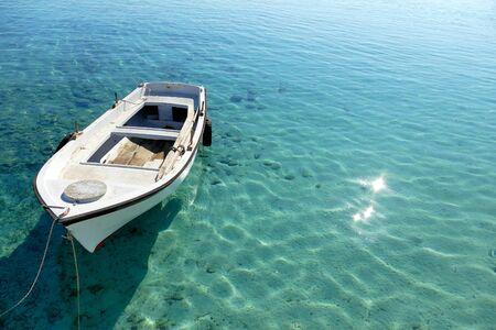 A darca and the blue sea of Diakofti, Kythera, Greece Stock fotó