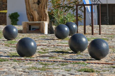 Iron balls in the central square of ancient Monemvasia, Greece