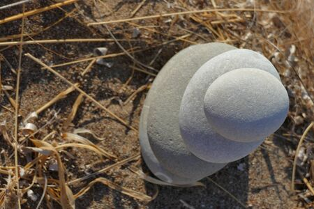 Composition of stones placed one on the other in the beach of Paleopoli in Kythira, Greece