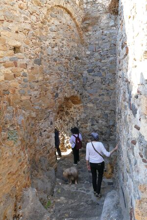 Tourists visit the city inside the mythical castle of Monemvasia