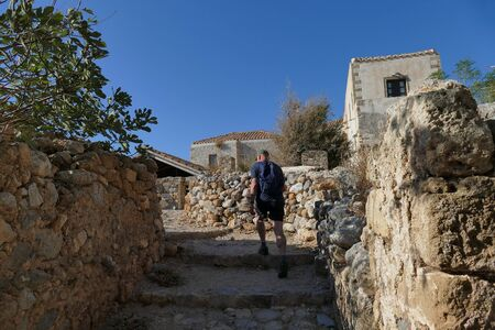 a tourist visit the city inside the mythical castle of Monemvasia Stock fotó