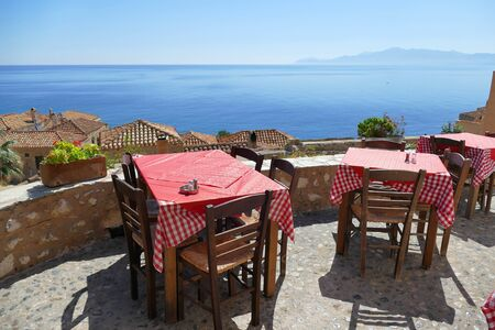 Tables of a restaurant with a beautiful view in Monemvasia, Greece