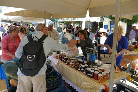 Kythera, Greece, 22 September 2019, tourists of various nationalities shop in the characteristic market of typical products in Potamos