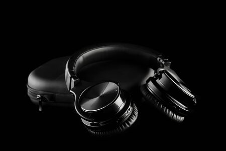wireless headphones on black background, isolated