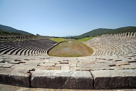Panoramic view of the stadium in ancient Messini archaeological site, south Peloponnese, Greece Фото со стока - 146859500