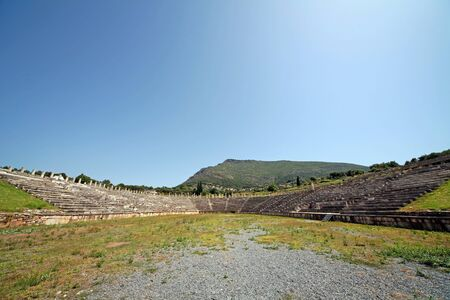 Panoramic view of the stadium in ancient Messini archaeological site, south Peloponnese, Greece Фото со стока - 146859476