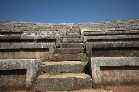 Panoramic view of the stairs of the stadium in ancient Messini archaeological site, south Peloponnese, Greece Фото со стока