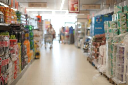 interior of a supermarket with customers shopping, defocused Banco de Imagens