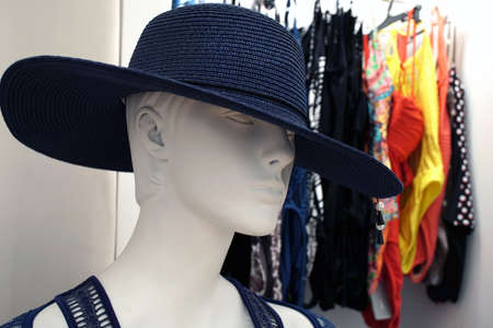Elegant female mannequin with hat in a shop window in Corfu, Greece