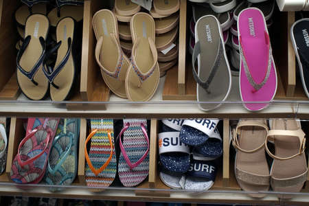 Corfu, Greece July 10, 2018 slippers and sandals for the sea for tourists in a boutique in Corfu