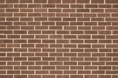 Newly constructed brown brick wall. Clean. Could be used as a background Stock Photo