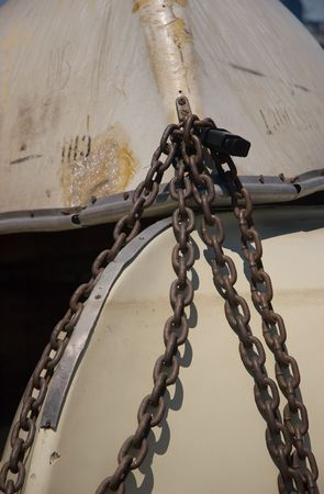 Chains securing two boats Stock Photo
