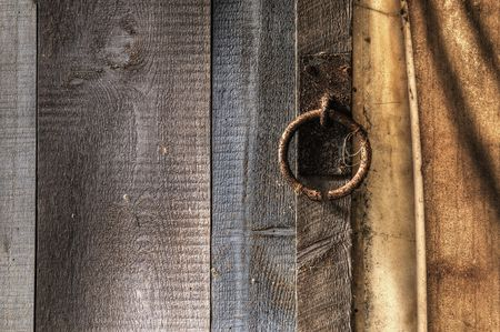 Rusted Metal Ring on a Wood Fence Stock Photo - 4616672