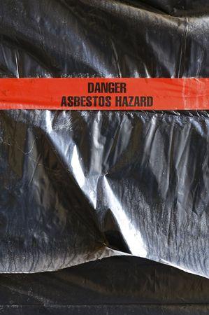 hazard tape: Danger Asbestos Hazard