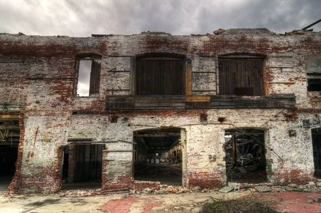 abandoned warehouse: Abandoned Brick Facade Stock Photo
