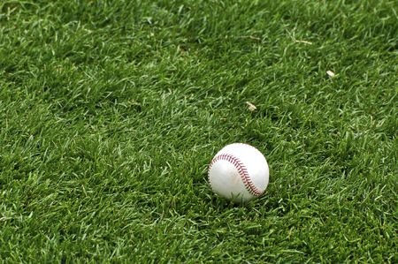 Baseball in the Grass Stock Photo