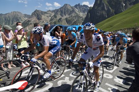 COL DU TOURMALET, FRANCE - JULY 12: A group of riders climb the final kilometer of the Col du Tourmalet in Stage 9 of the 2009 Tour de France on July 12, 2009 in France