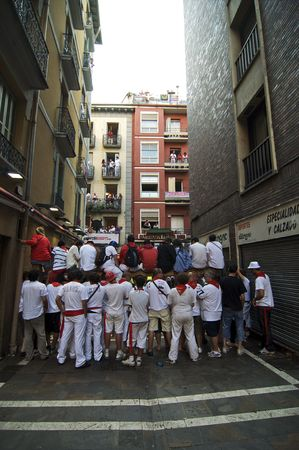 PAMPLONA, SPAIN - JULY 13: Spectators start to fill a small street before the Running of the Bulls on July 13, 2009 in Pamplona, Spain
