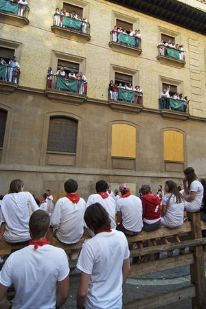 PAMPLONA, SPAIN - JULY 13: Spectators site on top of the fence and fill balconies before the Running of the Bulls on July 13, 2009 in Pamplona, Spain Editorial