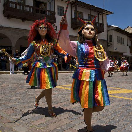 CUZCO, PERU - OCTOBER 8: Women in colorful traditional dresses and masks dance in the Virgen del Rosario Festival near the Plaza de Armas in Cuzco, Peru on October 8, 2009