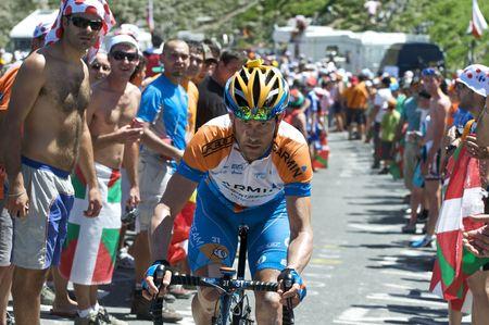 COL DU TOURMALET, FRANCE - JULY 12: A Garmin rider climbs the Col du Tourmalet in Stage 9 of the 2009 Tour de France on July 12, 2009 in France Editorial