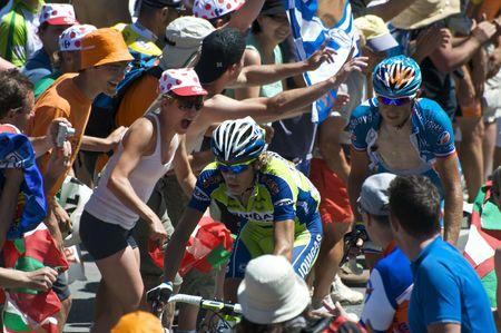 COL DU TOURMALET, FRANCE - JULY 12: Two of the leaders climb the Col du Tourmalet in Stage 9 of the 2009 Tour de France on July 12, 2009 in France.