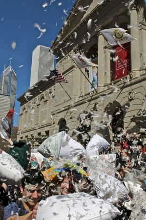 CHICAGO, IL - APRIL 4: Chicago residents join in World Pillow Fight Day in front of the Art Institute April 4, 2009 in Chicago, IL. Similar fights were held in more than 70 cities all around the world.
