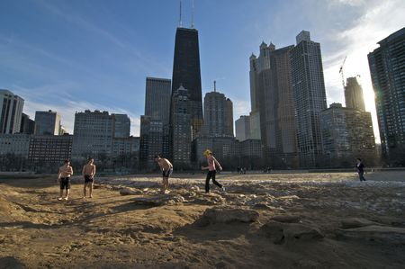 CHICAGO, IL - FEBRUARY 10: Several People take advantage of the record temperatures and go for a swim on February 10, 2009 at Oak Street Beach in Chicago, IL  Editorial
